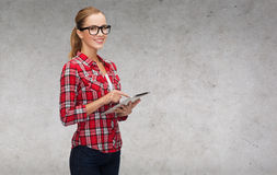Smiling girl in eyeglasses with tablet pc computer Stock Photography