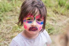 Smiling girl with face art painting like tiger, little boy making face painting, halloween party, child with funny face painting. Little cute boy with faceart stock images