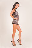 Smiling girl in fashion outfit. Studio isolated royalty free stock photo