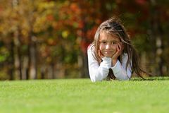 Smiling girl on field Stock Photography