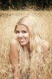 Smiling girl in a field Royalty Free Stock Photography