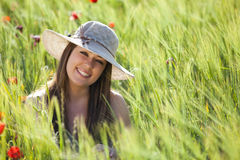 Smiling girl on field. Young smiling beautiful girl staring at camera Royalty Free Stock Photo