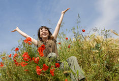 Smiling girl in field Stock Photo