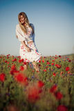 Smiling girl in field of flowers Stock Photography