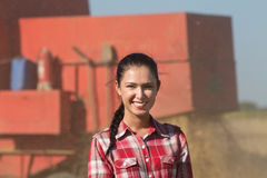 Smiling girl in the field Royalty Free Stock Image