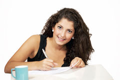 Smiling girl filling document Royalty Free Stock Image