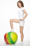 Smiling girl with a fitball Stock Image