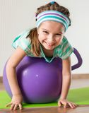 Little girl doing gymnastic exercises Royalty Free Stock Images