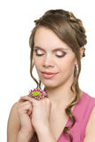 Smiling girl with a flower Stock Image