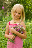 Smiling Girl with Flowers Royalty Free Stock Image