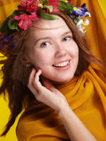 Smiling girl with flowers Royalty Free Stock Images
