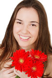 Smiling girl with flowers isolated on white Royalty Free Stock Images