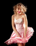Smiling girl with fluttering dress Stock Photo
