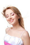 Smiling girl with flying hair. Over white background stock image