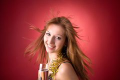 Smiling girl with flying hair and champagne glass stock photos