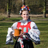 The smiling girl in folk costume Royalty Free Stock Image