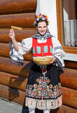 The smiling girl in folk costume Stock Images