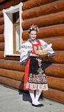 The smiling girl in folk costume. With scuttle with eggs Royalty Free Stock Photos