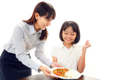 Smiling girl with food Royalty Free Stock Images