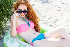 Smiling girl with freckles on the beach Royalty Free Stock Images