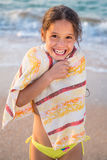 Smiling girl frozen on the beach Stock Images