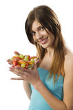 Smiling girl with fruit royalty free stock images