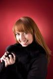 Smiling girl in fur coat Stock Images