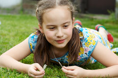 Smiling girl in garden Royalty Free Stock Images