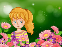 A smiling girl at the garden with fresh flowers Stock Photo