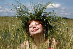 The smiling girl in a garland Royalty Free Stock Photos