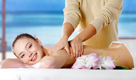 Smiling girl  getting spa massage Stock Images