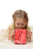 Smiling girl with gift box Royalty Free Stock Photos
