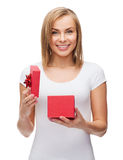 Smiling girl with gift box Stock Photography