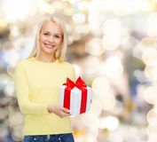 Smiling girl with gift box Royalty Free Stock Image