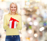 Smiling girl with gift box Stock Photos