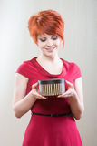 Smiling girl with a gift box Stock Photos