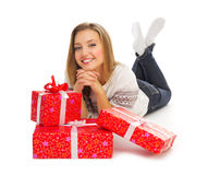 Smiling girl with gift boxes Royalty Free Stock Images