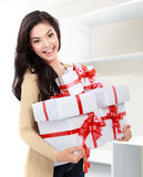 Smiling girl with a gift boxes Royalty Free Stock Images