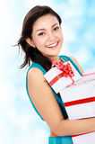Smiling girl with a gift boxes. Portrait of smiling young girl bring some gift boxes Royalty Free Stock Image