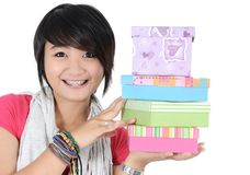 Smiling girl with gifts. Isolated on white background Stock Photos