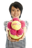 Smiling girl giving flower. Smiling asian young girl giving congratulation toy flower, isolated Royalty Free Stock Photo