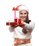 The smiling girl is giving the presents Royalty Free Stock Photography