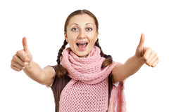 Smiling girl giving thumbs up gesture Stock Images