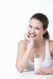 Smiling girl with a glass of milk Stock Images