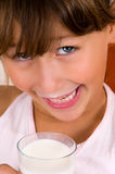 Smiling girl with a glass of milk Royalty Free Stock Photography