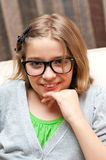 Smiling girl in glasses Stock Photography