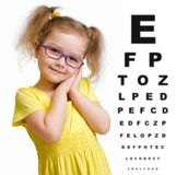 Smiling girl in glasses with eye chart isolated. On white royalty free stock image