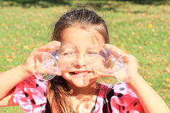 Smiling girl with glasses on eyes Royalty Free Stock Images