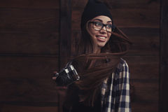 Smiling girl in glasses with vintage camera Royalty Free Stock Images