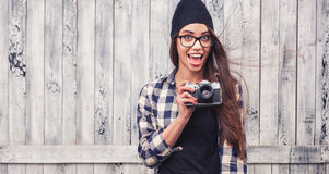 Smiling girl in glasses with vintage camera Stock Photos